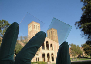 Window glass dressed with the new transparent polymer solar cell, made from photoactive plastic, which produces energy by absorbing and converting infrared light into an electric current. ©UCLA