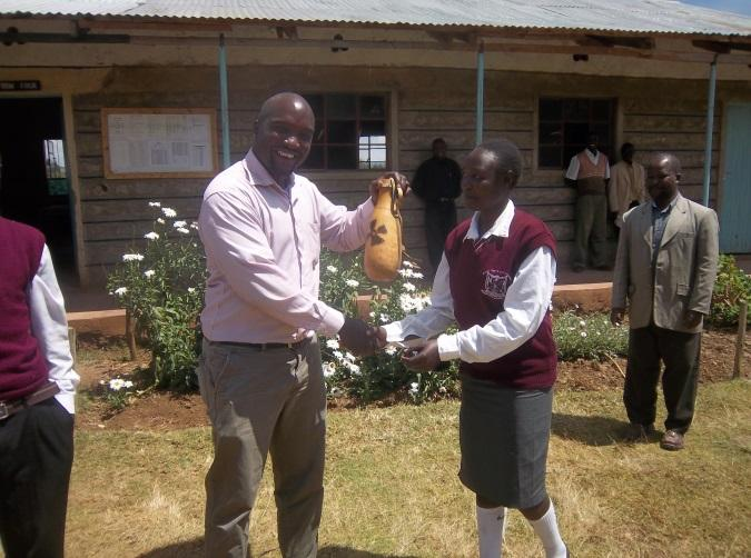 Cheplelachebei East Secondary School students dispatch a symbolic gourd of appreciation to their benefactors for the lamps' donation © Nokero