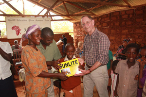 A child is presented with a Sunlite lamp in a bid to improve learning outcomes © HEART