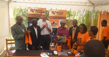 Barefoot presents its 5W solar home lighting system to the parents of Uganda's gold medalist Stephen Kiprotich © Barefoot Power
