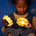 An Ethiopian child admires the Little Sun lamp © Merklit Mersha /2012 Little Sun
