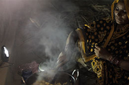 A woman in India prepares an evening meal for her family lighting up her kitchen with a solar lantern © Lighting Asia - India